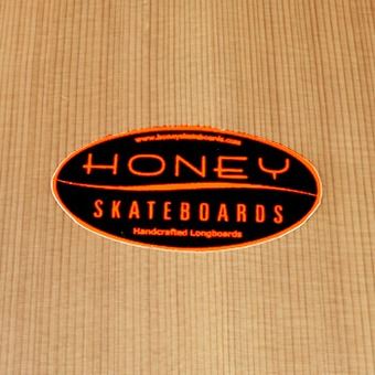 Honey Sticker Orange on Black Oval Small