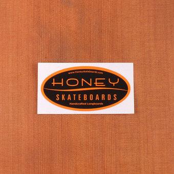 Honey Sticker Orange on Black Oval Medium